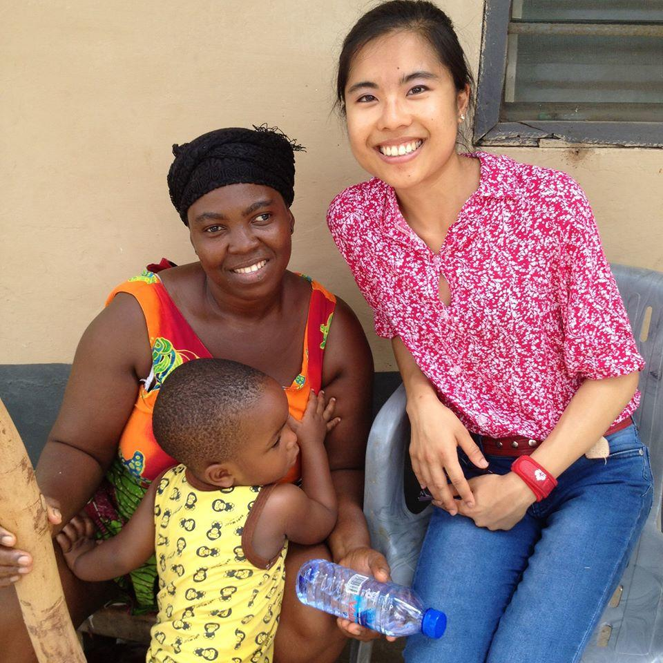 A female intern from Projects Abroad is pictured with a local woman and her child whilst on her speech therapy internship in Ghana.